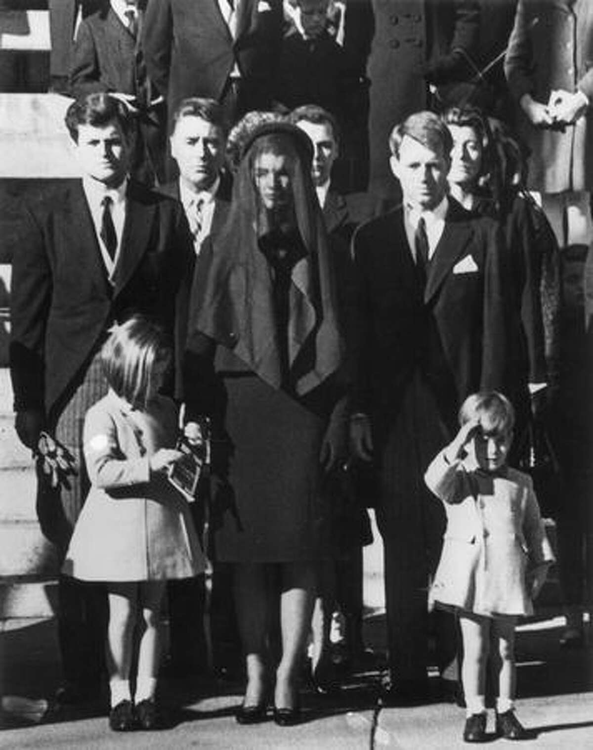 Members of the Kennedy family at the funeral of assassinated president John F. Kennedy at Washington DC. From left: Senator Edward Kennedy, Caroline Kennedy, (aged 6), Jackie Kennedy (1929 - 1994), Attorney General Robert Kennedy and John Kennedy (1960 - 1999) (aged 3).
