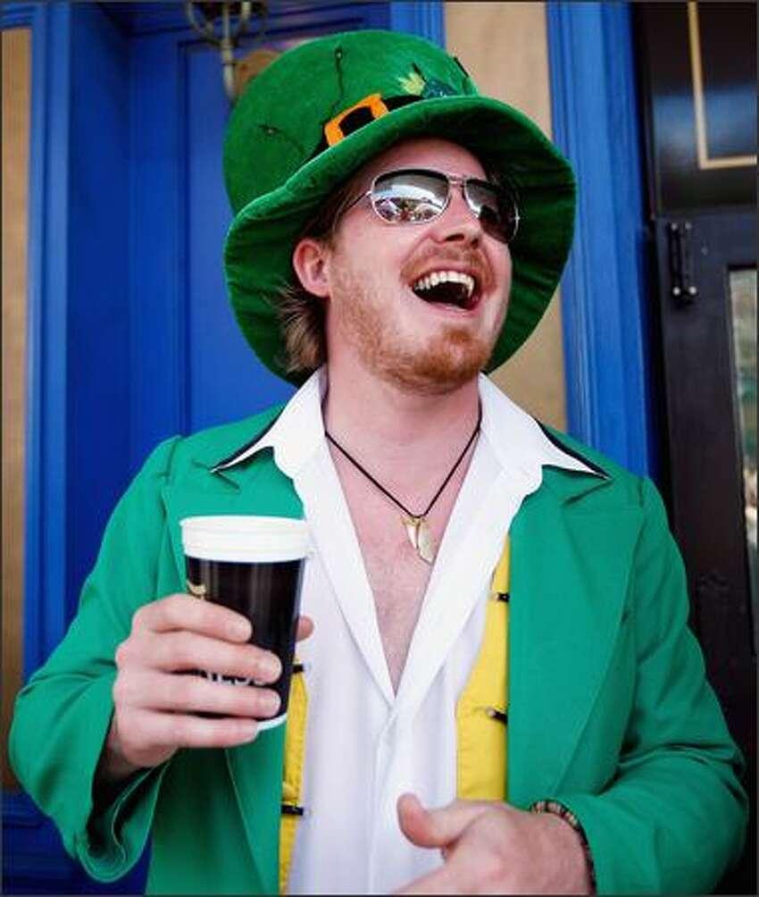 Donny Shanahan enjoys the festivities on St. Patrick's Day at the Muddy Farmer Bar in Auckland, New Zealand.