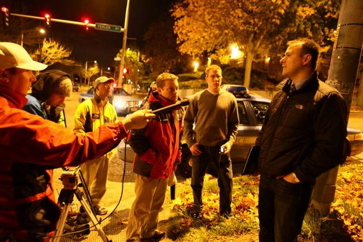 Seattle Police Sgt. Sean Whitcomb addresses the news media at the scene where a Seattle Police officer was killed in the line of duty on Saturday October 31, 2009 in Seattle's Leschi Neighborhood. It was the first officer shot to death in the city since 1994.
