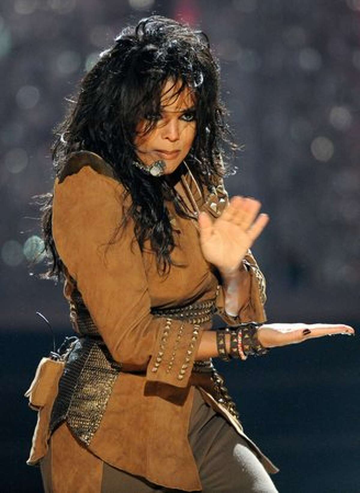 Singer Janet Jackson performs onstage.