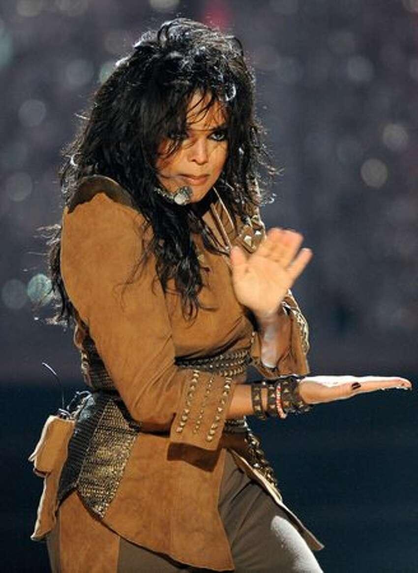Singer Janet Jackson performs onstage.