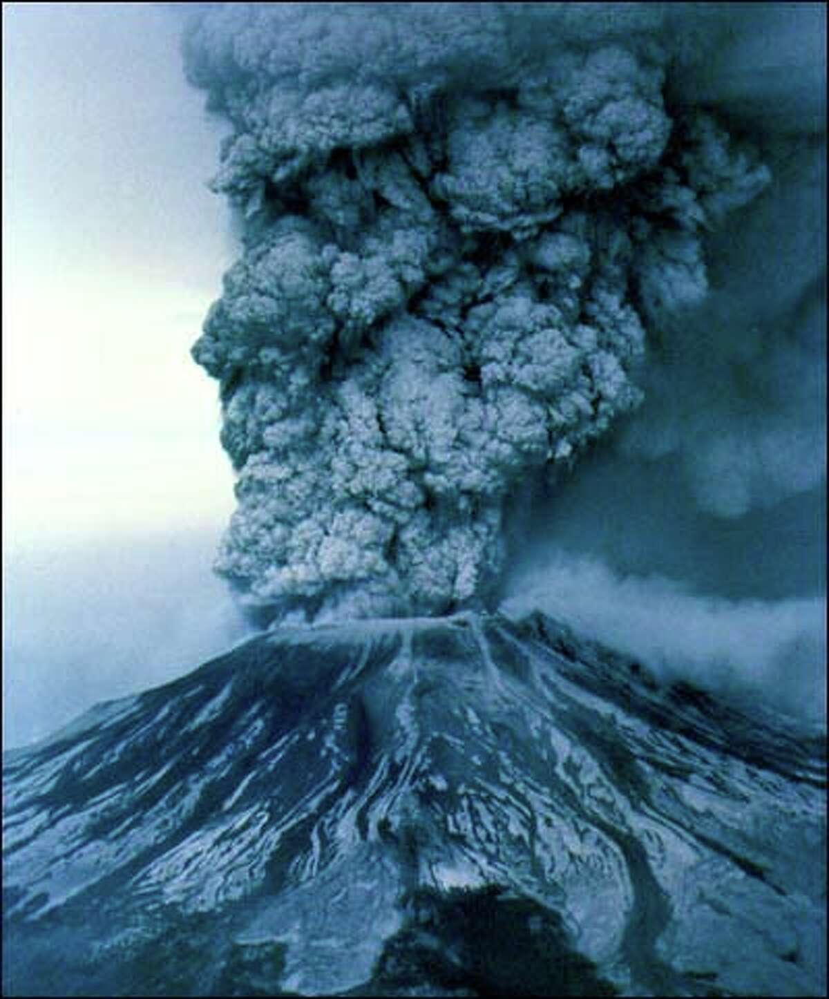 With the fury of a 24-megaton atomic bomb, hot volcanic ash exploded 60,000 feet into the sky. The blast killed 57 people.