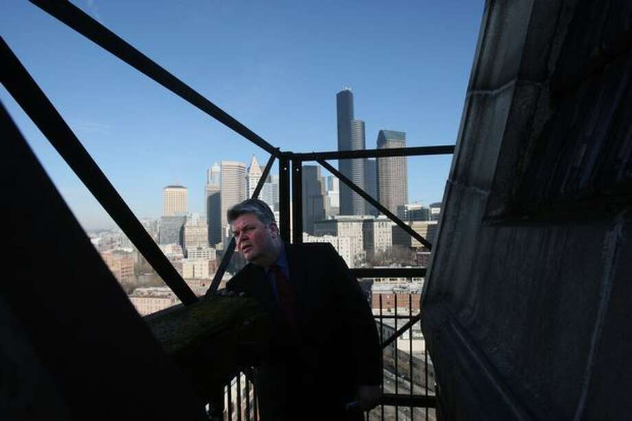 Mayor Greg Nickels stands on the outer balcony of the clock tower at King Street Station, March 5, 2008. (Mike Kane/seattlepi.com file)