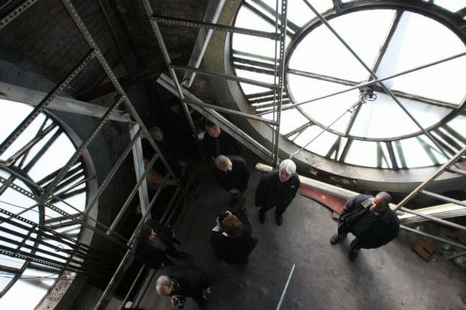 Participants of a media tour peruse the top of the clock tower at King Street Station, March 5, 2008. (Mike Kane/seattlepi.com file)