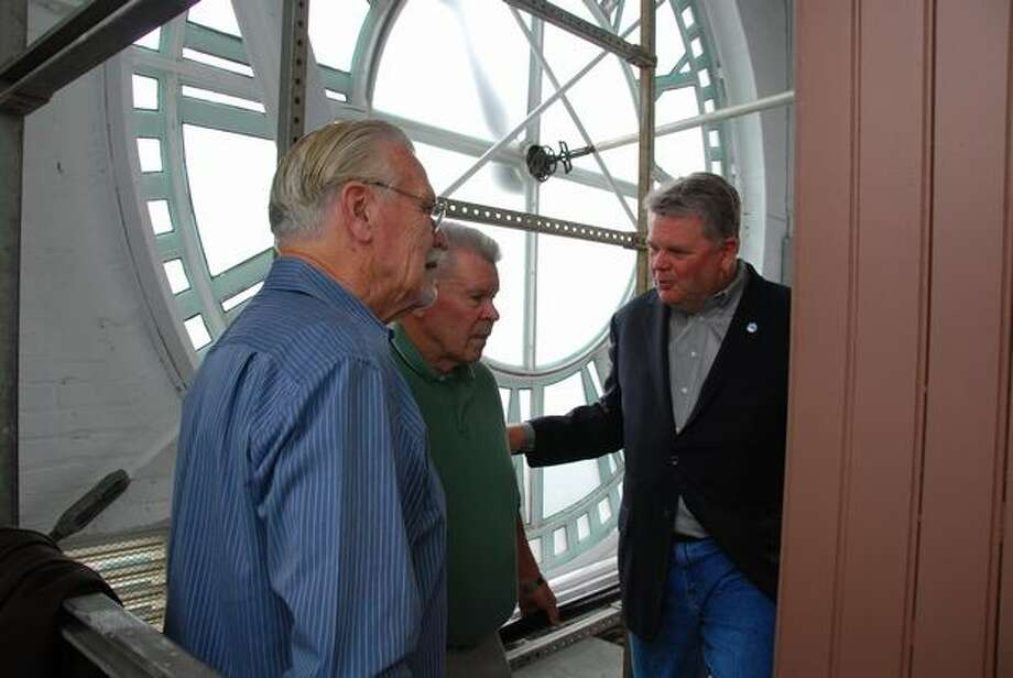 Seattle Mayor Greg Nickels with two volunteers who helped restore the King Street Station clock, Sept. 1, 2009. (Seattle Department of Transportation photo)