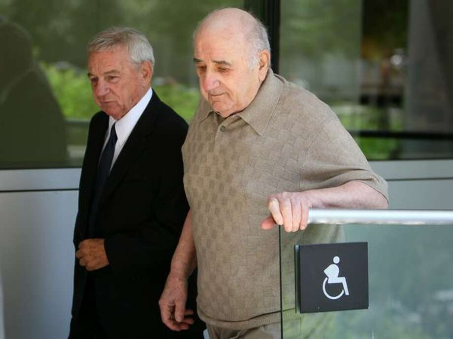 Frank Colacurcio Sr., right, and his associate John Gilbert Conte enter the U.S. Courthouse in Seattle on Friday to appear before U.S. Magistrate Judge James P. Donohue. Colacurcio, Conte and four others pleaded not guilty to federal charges of racketeering, money laundering and facilitation of prostitution. (Photo/Seattlepi.com, Joshua Trujillo) Photo: Joshua Trujillo/seattlepi.com