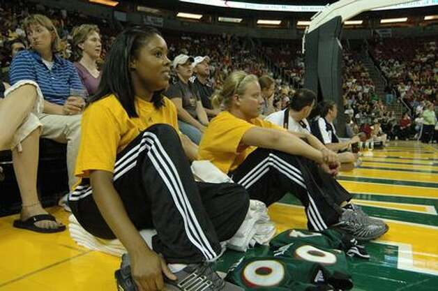 Tamika Kelly, left, has worked 10 years as a Seattle Storm ballgirl. Lindsay Marsaw, right, has sat courtside for two years. Photo: Daniel Berman/seattlepi.com