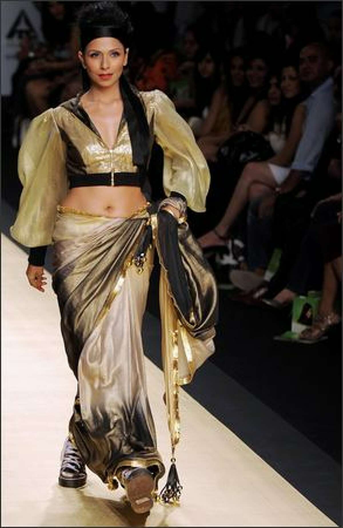 A model presents creations by Indian designer Manish Malhotra during the Wills India Fashion Week (WIFW) in New Delhi.