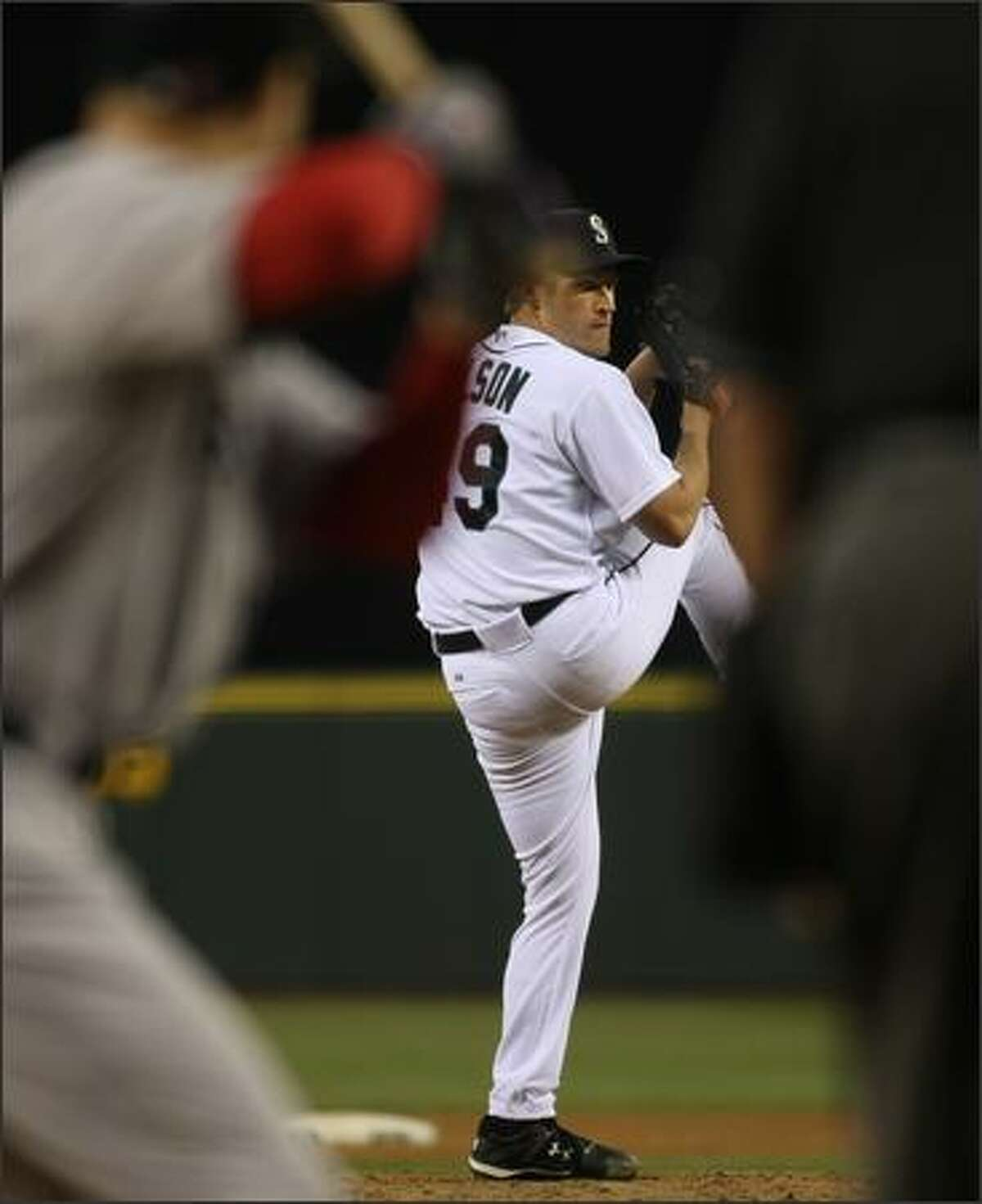 Garrett Olson pitches during the 5-3 loss to the Boston Red Sox at Safeco Field.