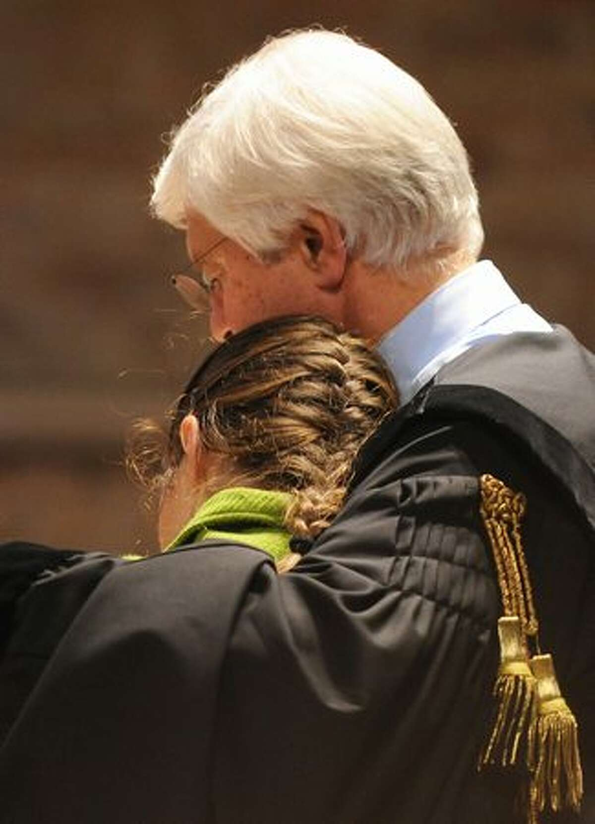 Amanda Knox is comforted by her lawyer Carlo Dalla Vedova during her trial in Perugia, Italy. Knox asked a jury not to put