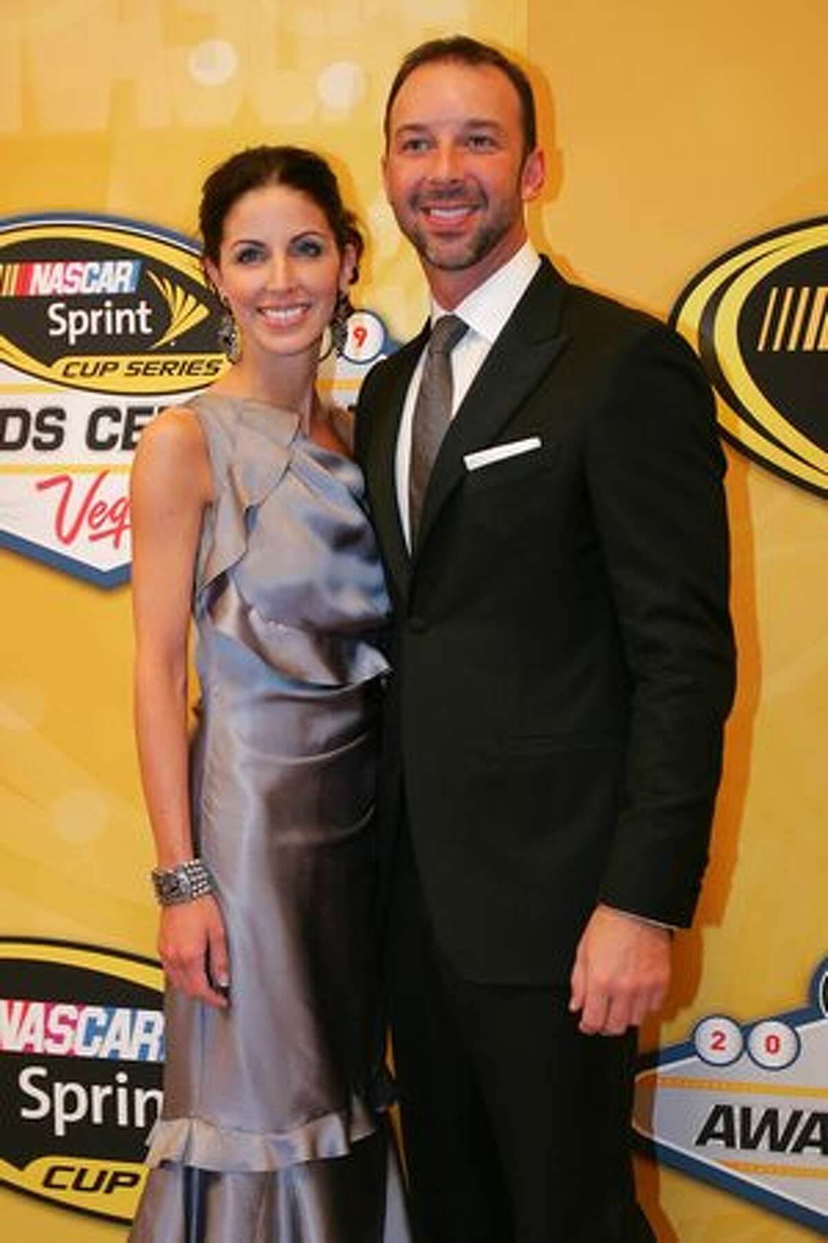 LAS VEGAS - DECEMBER 04: Crew chief Chad Knaus (R) and Lisa Rockelmann pose pose on the red carpet for the NASCAR Sprint Cup Series awards banquet during the final day of the NASCAR Sprint Cup Series Champions Week on December 4, 2009 in Las Vegas, Nevada.