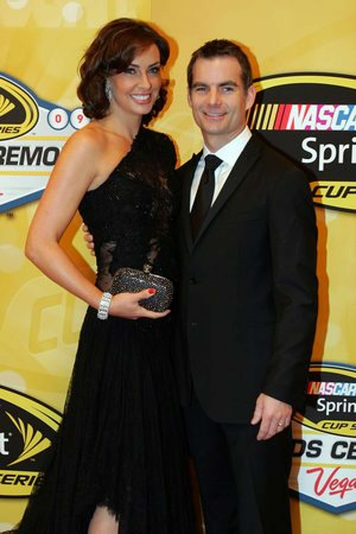 LAS VEGAS - DECEMBER 04: NASCAR driver Jeff Gordon (R) and his wife Ingrid Vandebosch pose on the red carpet for the NASCAR Sprint Cup Series awards banquet during the final day of the NASCAR Sprint Cup Series Champions Week on December 4, 2009 in Las Vegas, Nevada.