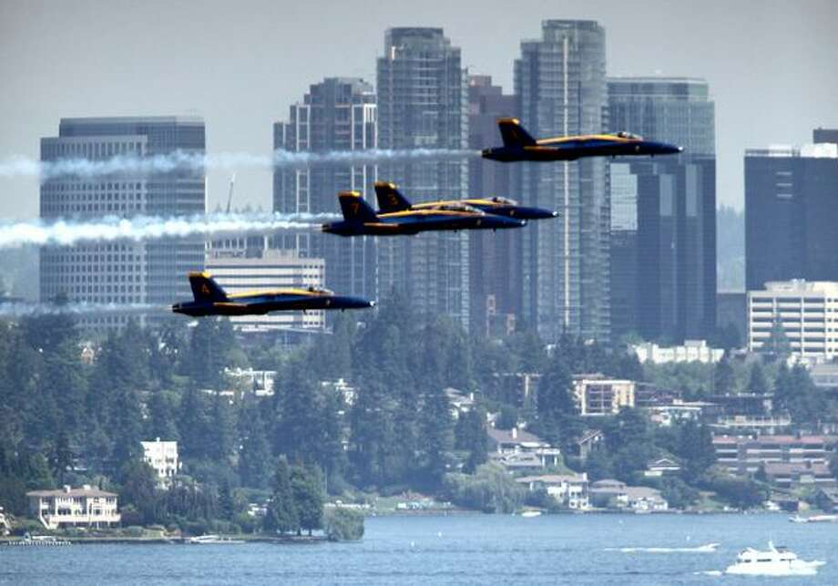 The U.S. Navy Blue Angels demonstration team fly their Boeing F/A-18 Hornets over Lake Washington and in front of downtown Bellevue during a practice on Thursday in Seattle. Photo: Joshua Trujillo/seattlepi.com