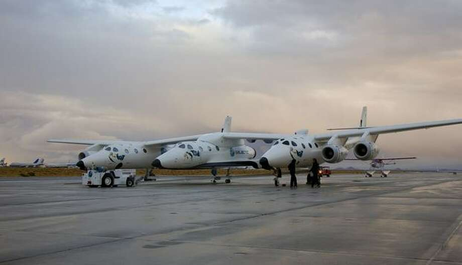 Virgin Galactic's SpaceShipTwo out of the hangar for the first time with mothership Eve before the official unveiling. (Virgin Galactic photo)