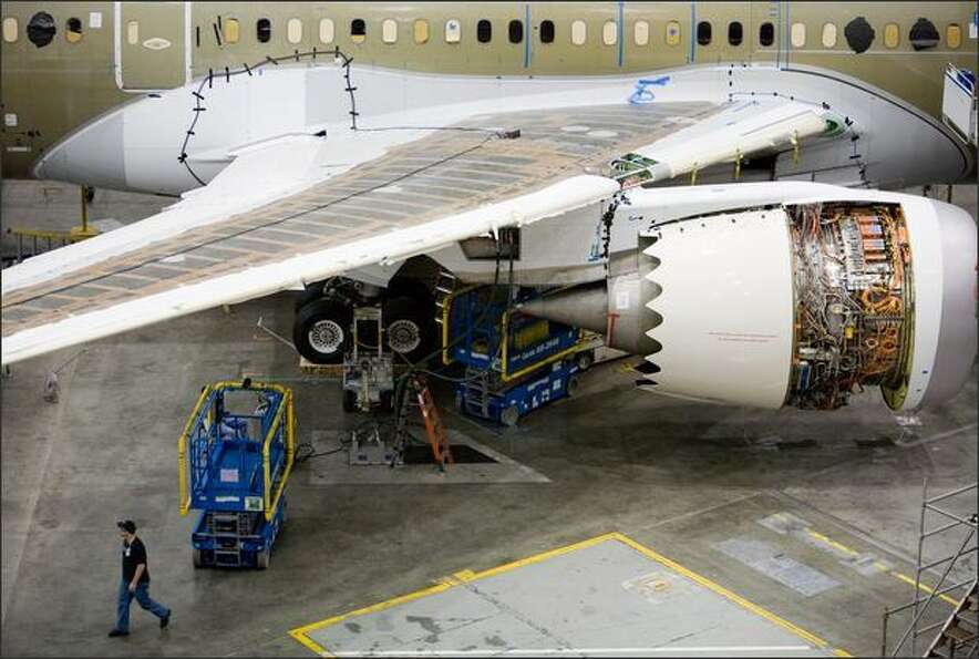 One of the Rolls Royce engines is shown on a plane being assembled on Boeing's 787 line in Everett o