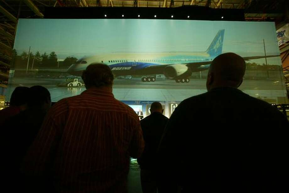 More than 5,000 Boeing employees watch a virtual 787 on a giant screen in a Virtual Roll-In ceremony at the company's Everett plant on Dec. 6, 2006. (Grant M. Haller/seattlepi.com file)