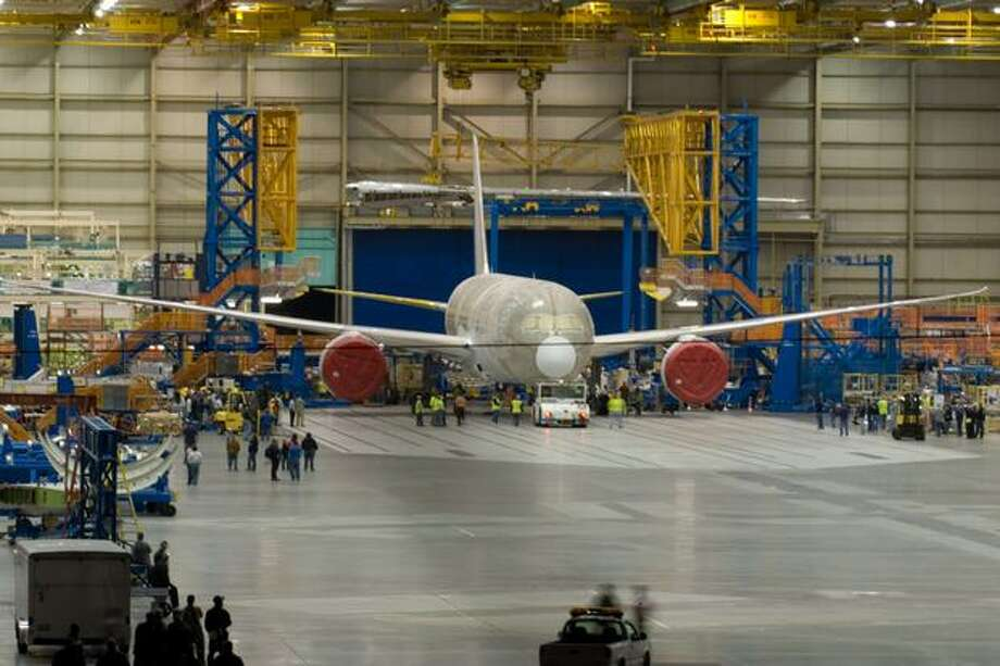 The first 787 Dreamliner sits inside the assembly bay in Everett after the doors were opened in the early morning on June 26, 2007, before being rolled outside and moved to a paint facility. (Charles Conklin/seattlepi.com file)