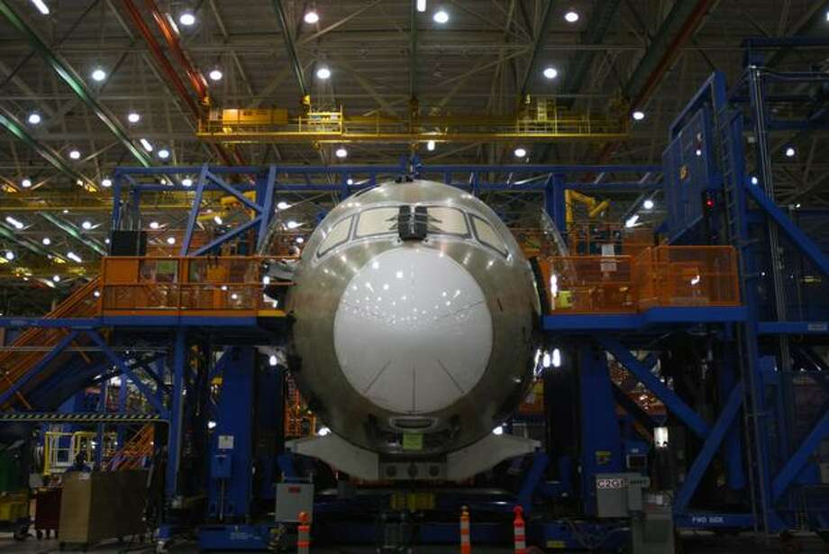 Boeing employees work on Boeing 787 on the production line at the Boeing factory in Everett, Wash., on May 19, 2008. (Mike Kane/seattlepi.com file)
