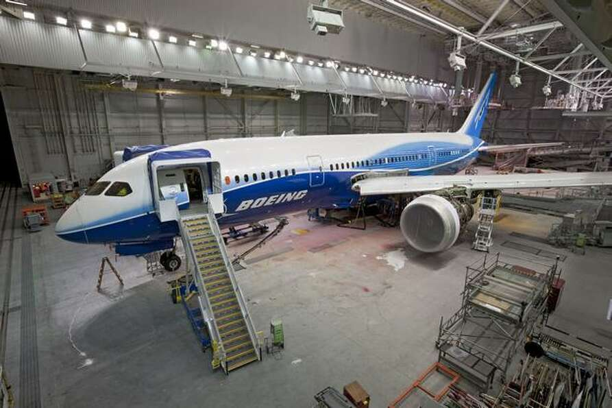 The first 787 Dreamliner in the Everett paint hangar where workers finished installing reinforcement