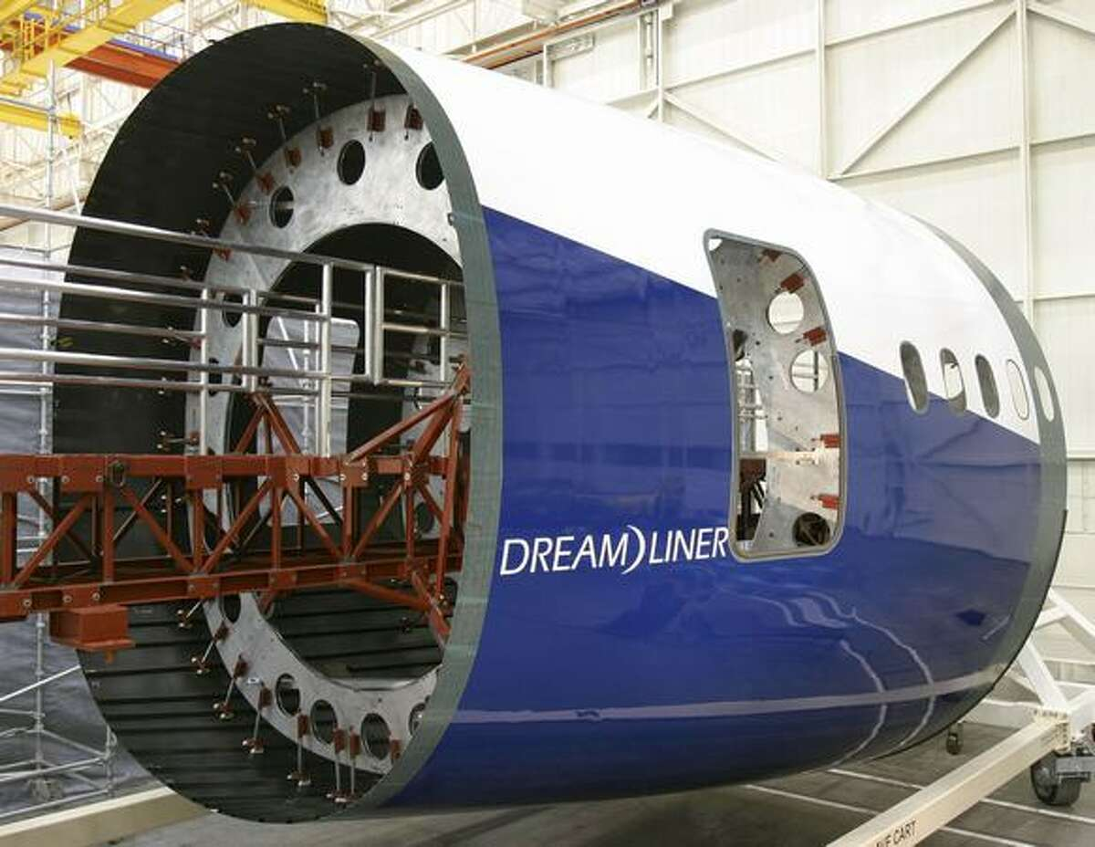Boeing unveils the first 7E7 Dreamliner composite fuselage section at its Developmental Center in Seattle in 2005. (Boeing photo by Ken DeJarlais)