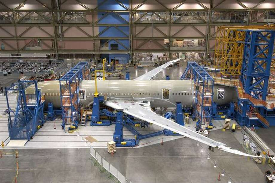 Installation of the wings on the first 787 on June 5, 2007. (Boeing photo)
