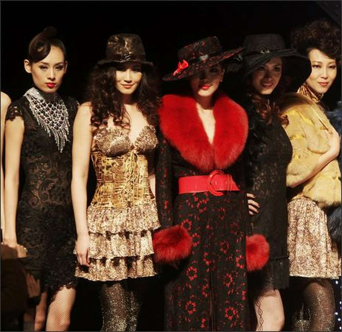 Models pose on the runway during the Judy-Galaxy Fashion Collection..