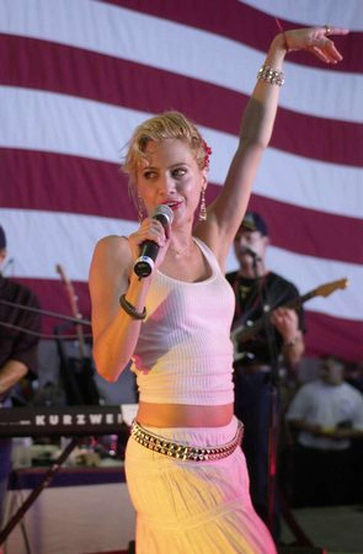 Brittany Murphy performs during a United Services Organization (USO) show aboard the USS Nimitz on June 19, 2002 in the Arabian Gulf.