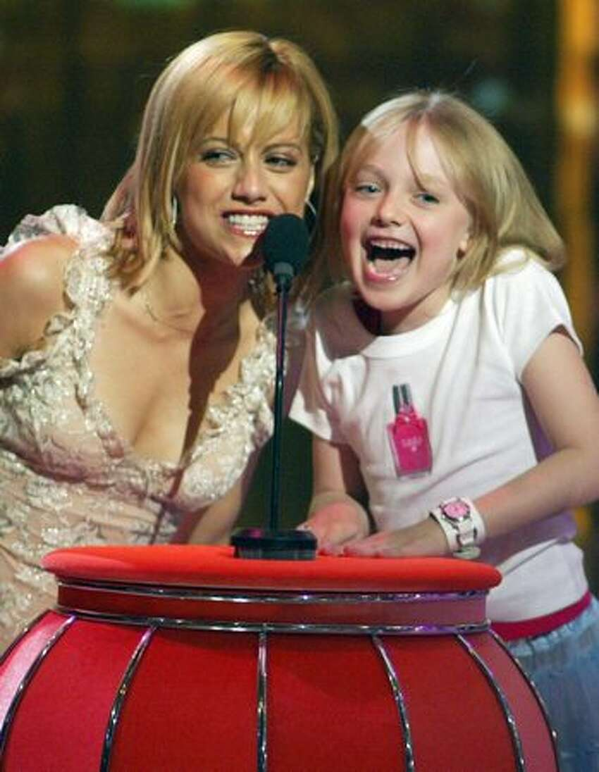 Brittany Murphy and Dakota Fanning present an award at the 2003 Teen Choice Awards on Aug. 2, 2003 in Universal City, Calif.