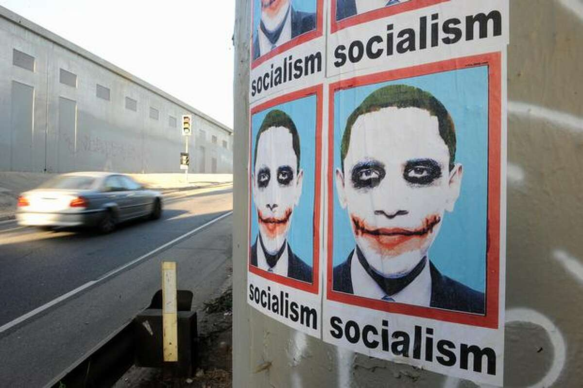 """A poster portraying President Barack Obama as """"The Joker"""" from the Batman movie """"The Dark Knight"""" is visible on a highway pillar in Los Angeles on Aug. 7."""