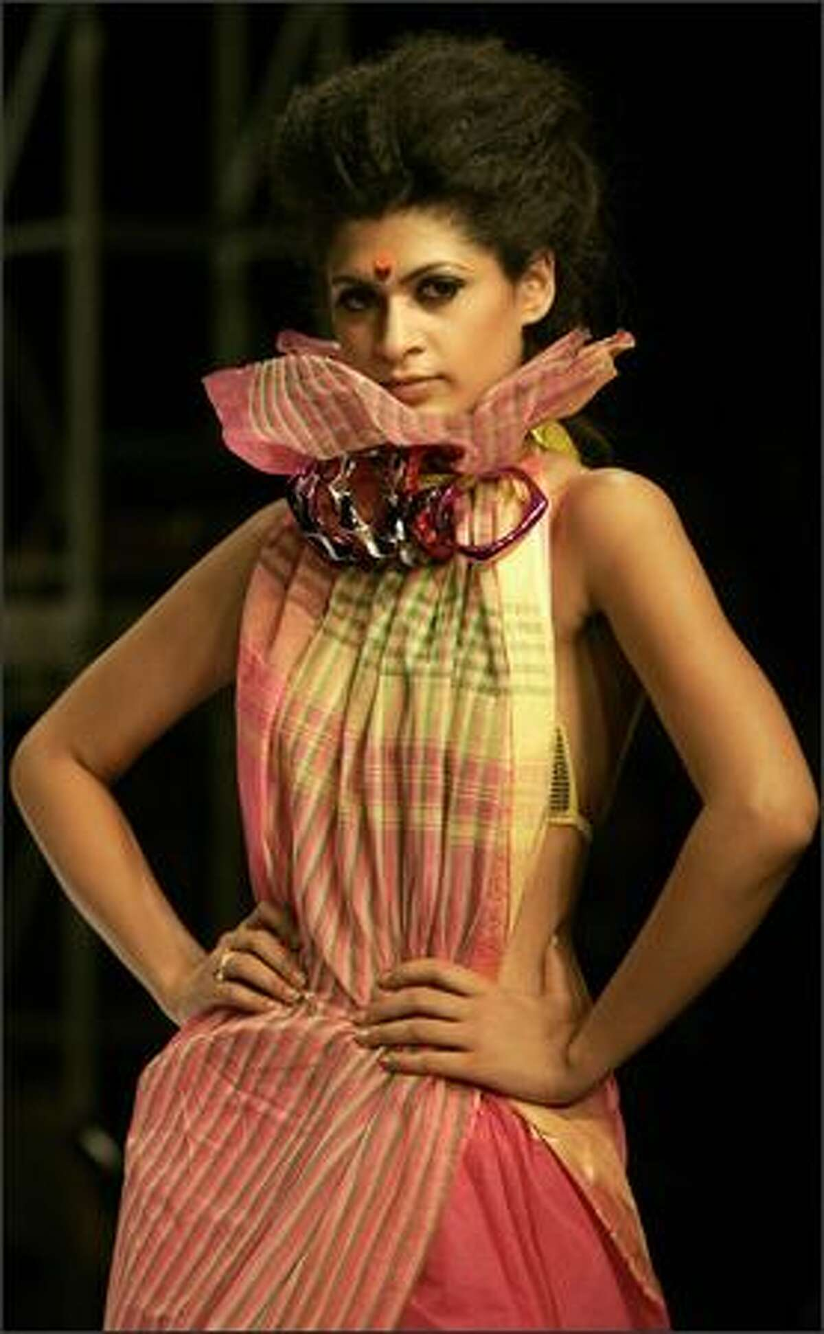 An Indian model showcases a creation from a local designer during the Kolkata Fashion Week in India.