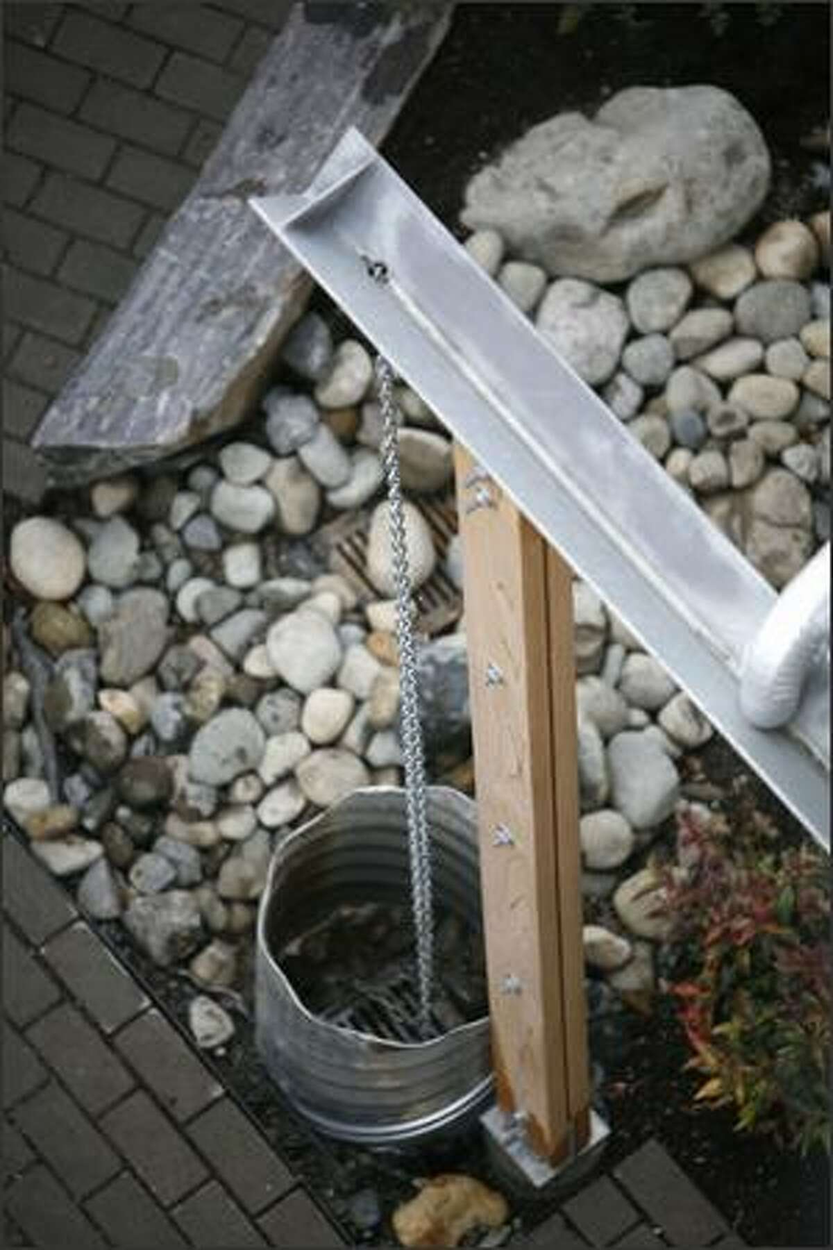 A rainwater collection system sends water into a cistern, where it is reused for flushing toilets and watering gardens.