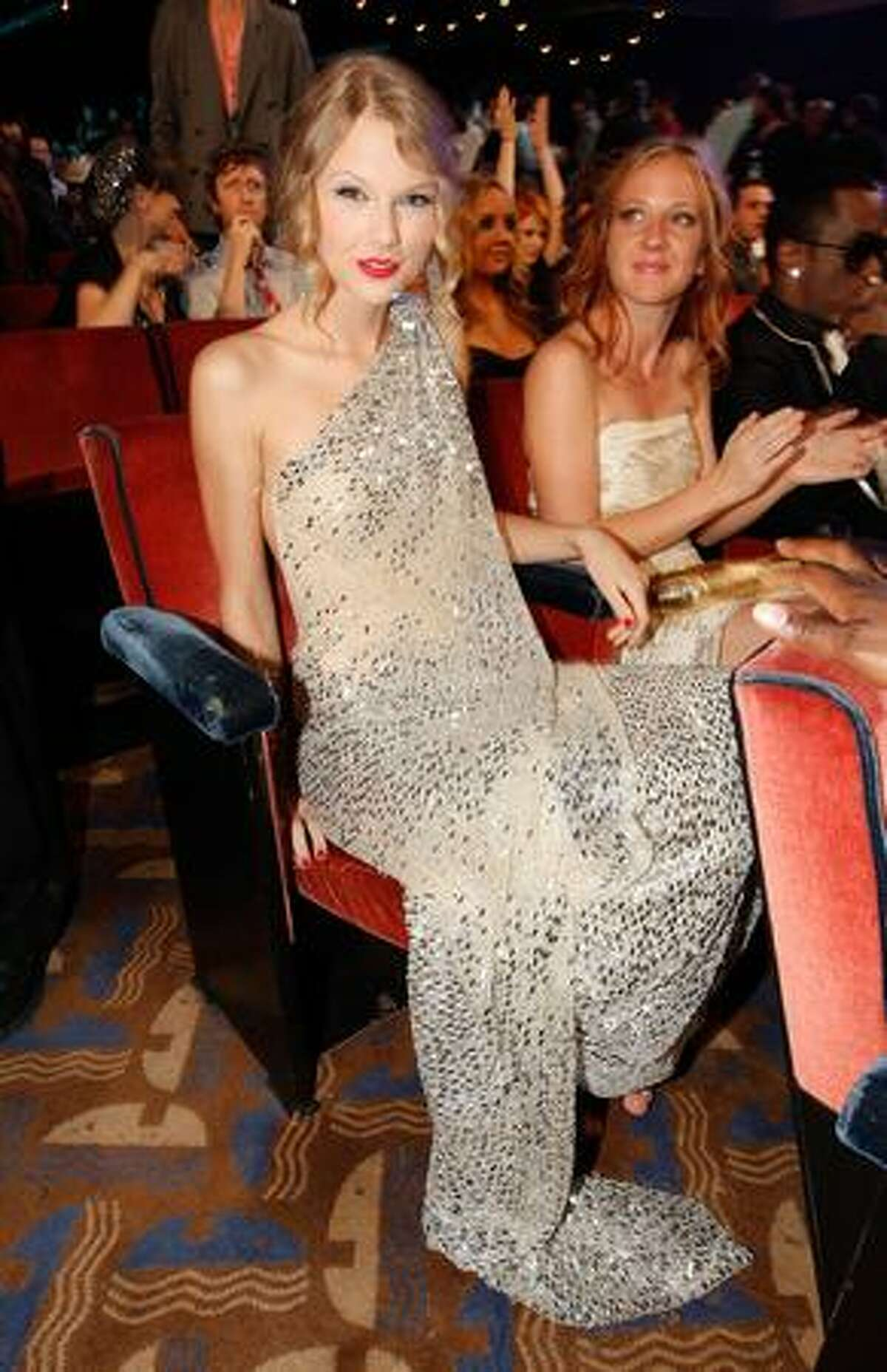 Taylor Swift sits in the audience.
