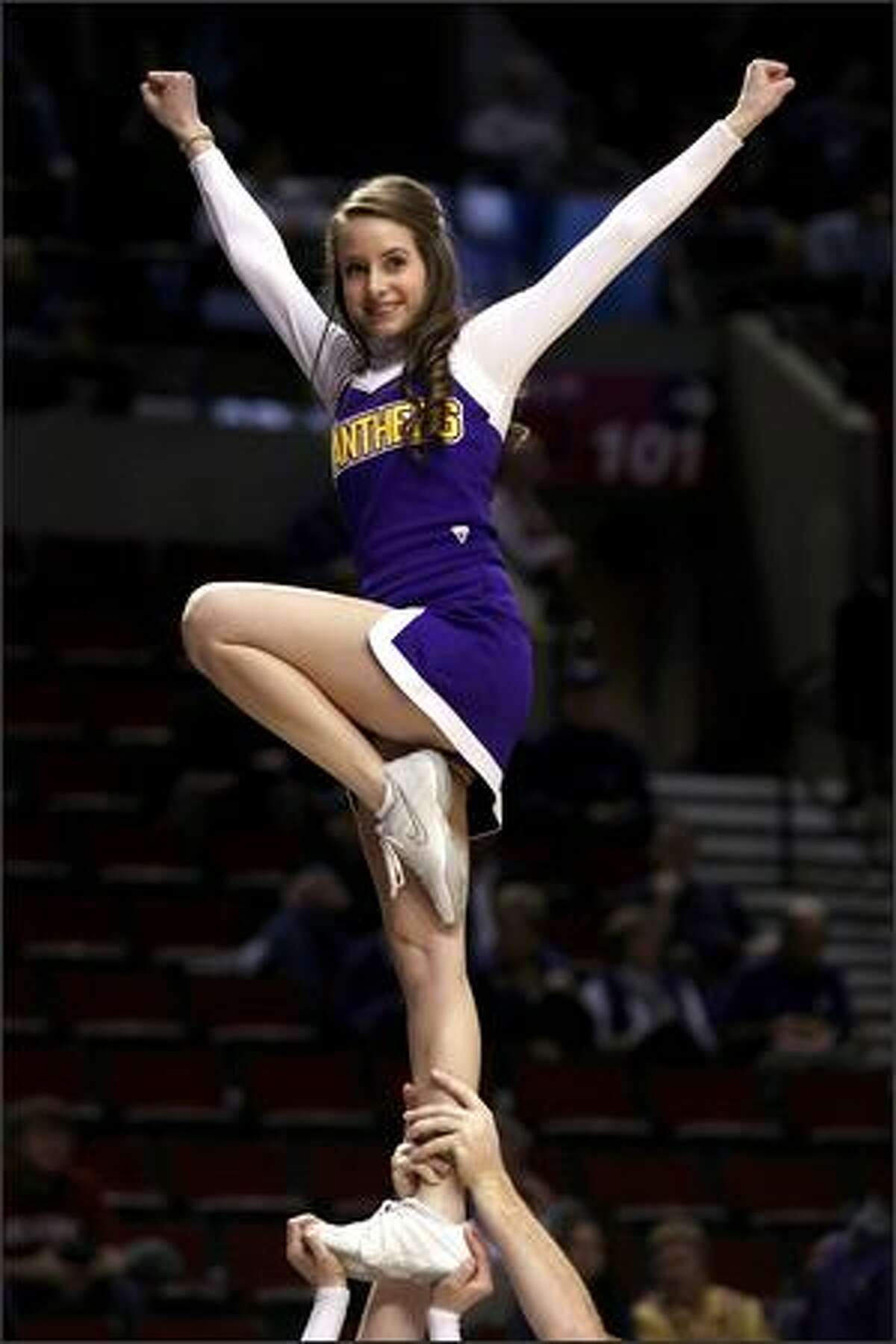 A member of the Northern Iowa Panthers cheerleading team performs during a break in the action while taking on the Purdue Boilermakers during the first round of the NCAA Division I men's basketball tournament at the Rose Garden in Portland, Ore., on March 19. All the photos in this gallery were taken from this year's tournament.