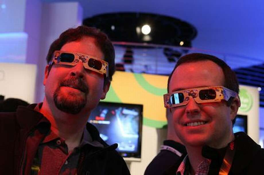 "Ben Sauselein, left, and Michael Donnelly of Wayne, N.J., check out the 3D views in the Xbox 360 game ""Scrap Metal"" on Thursday at CES 2010 in Las Vegas. Photo: Microsoft"