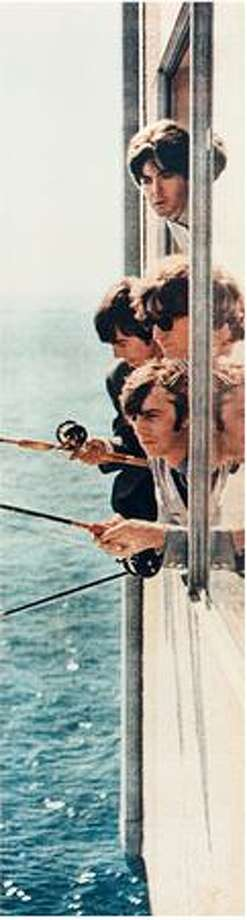 The Beatles fishing from a window in suite 272 at the Edgewater Hotel, Aug. 21, 1964. (Photo courtesy Edgewater Hotel) Photo: /