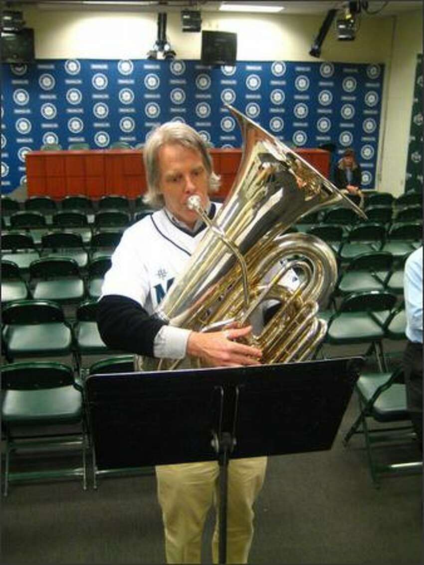 Mark Lloyd uses the Mariners' interview room to practice for a performance Tuesday at the Mariners home opener.