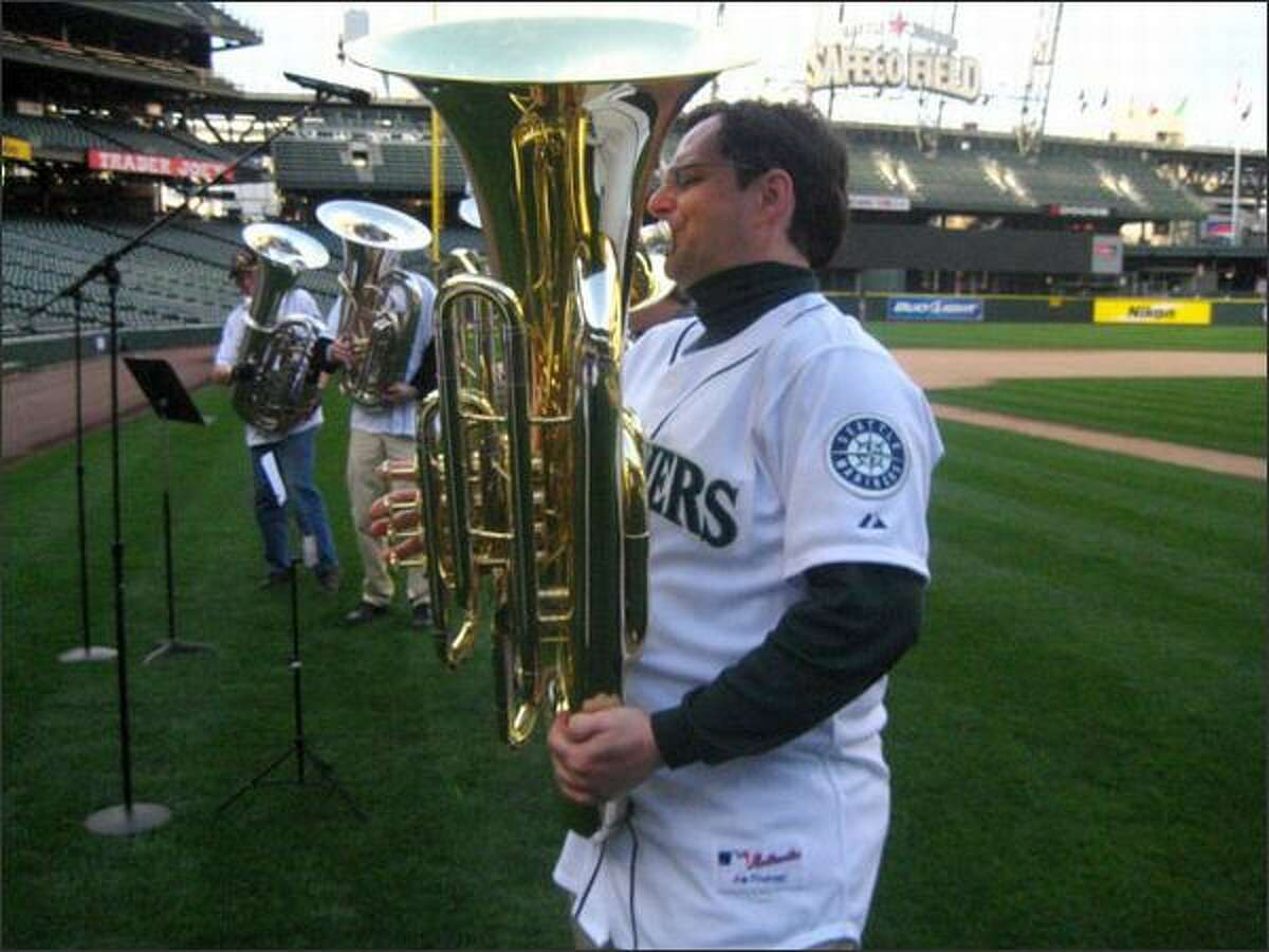 Tuba player Mike Woolf practices for Tuesday's tribute to Tuba Man Edward McMichael.