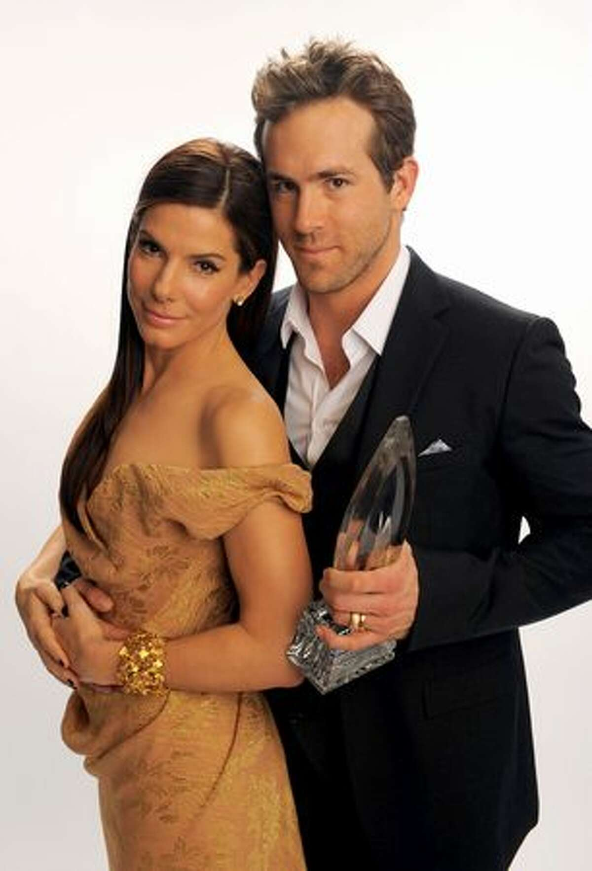 Actors Sandra Bullock and Ryan Reynolds pose for a portrait for Favorite Comedy Movie during the People's Choice Awards 2010 held at Nokia Theatre L.A. Live in Los Angeles on Wednesday, Jan. 6, 2010.