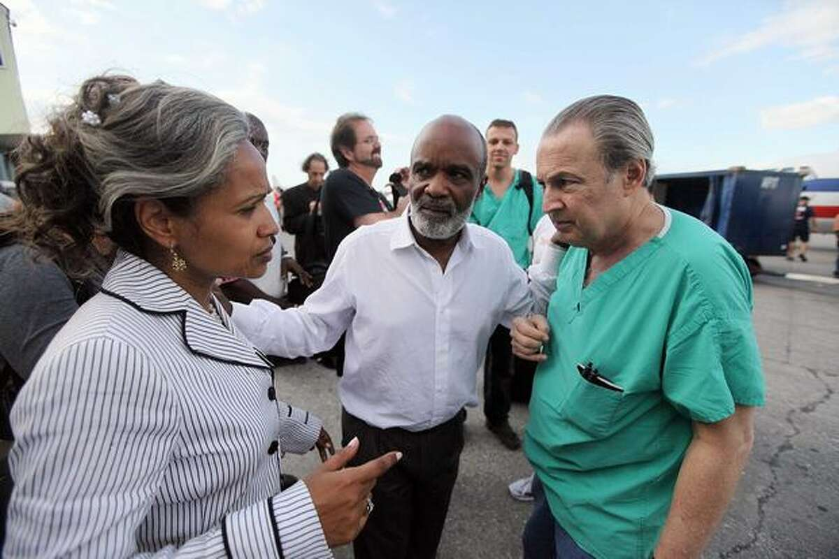Haitian president Rene Preval (center) and his wife, Elisabeth Débrosse Delatour, meet with Dr. Barth Green, chairman of the Department of Neurosurgery at the University of Miami, as he brings a team of doctors to help with disaster victims on Jan. 13, 2010 in Port-au-Prince, Haiti.