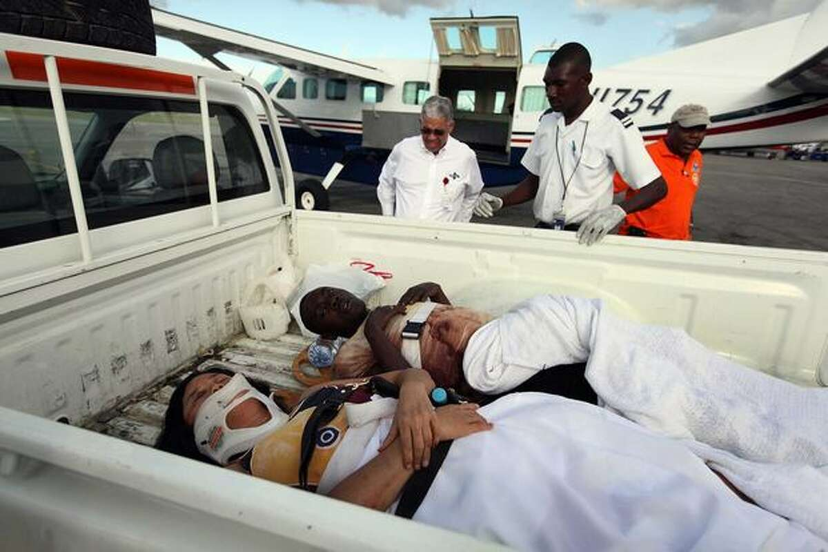 Injured people are prepared for air transport at the Port-au-Prince International airport on Jan. 13, 2010 in Port-au-Prince, Haiti.