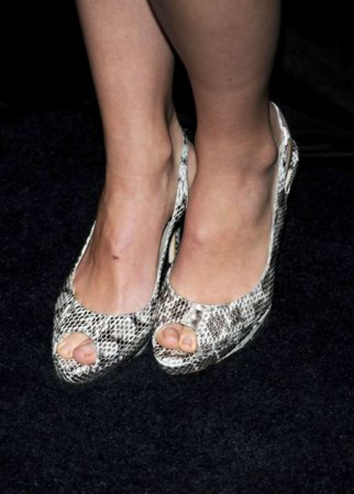 Actress Olivia Wilde arrives.