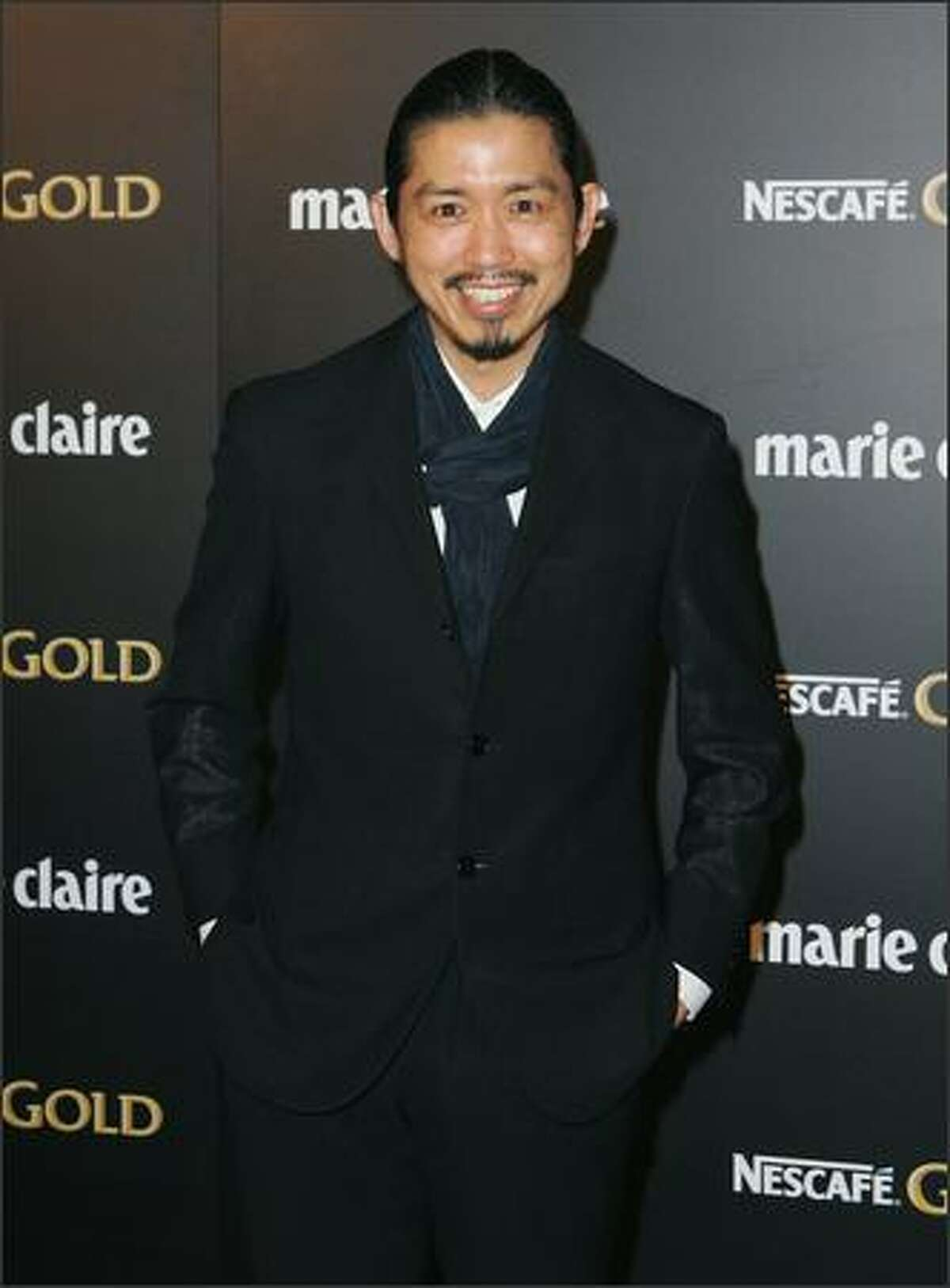 Fashion designer Akira arrives for the 2009 Prix de Marie Claire Awards at the Royal Hall of Industries in Sydney, Australia.