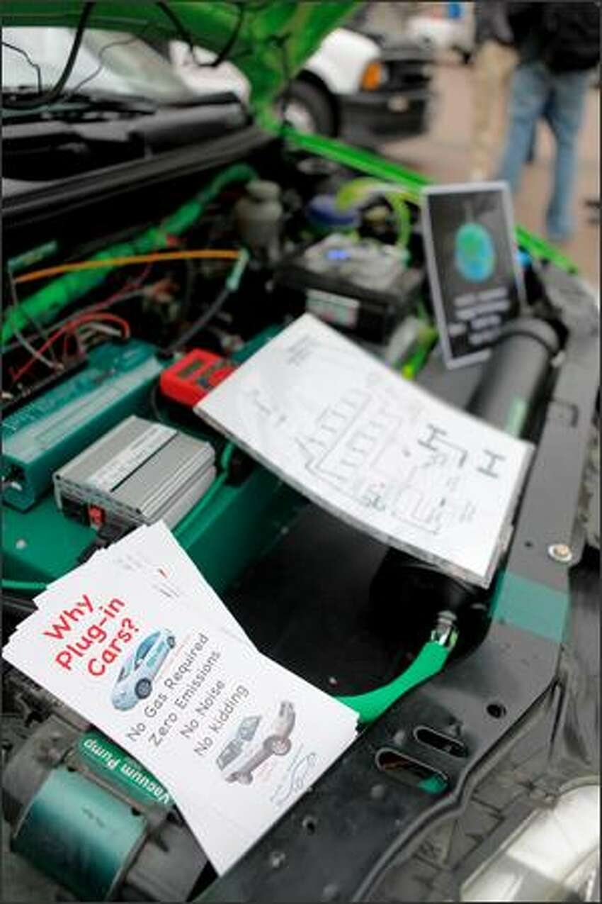 The hood of a 2000 Chevrolet Metro, converted into an all-electric vehicle tabbed the