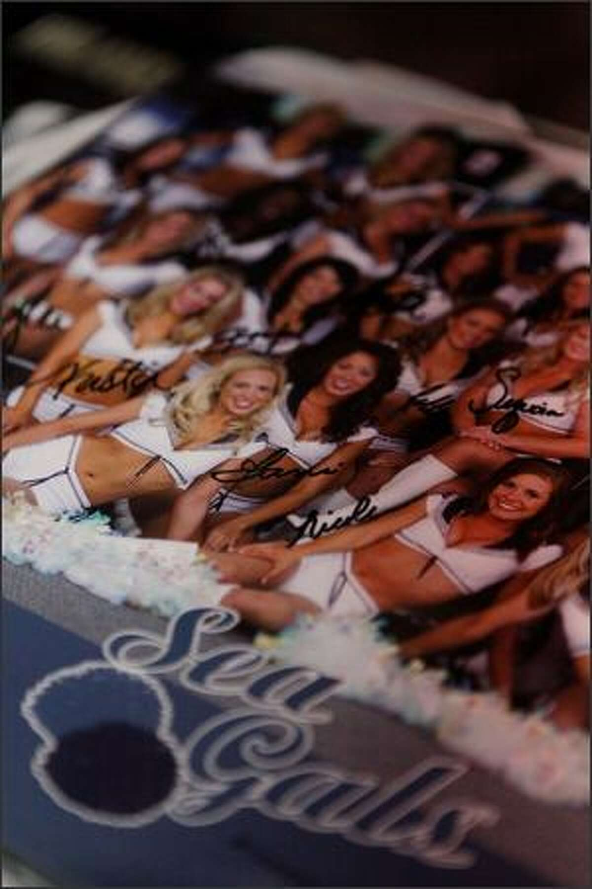Signed 2008 Sea Gals posters rested on a table during the Sea Gals auditions at the Qwest Field West Club Lounge on Sunday.