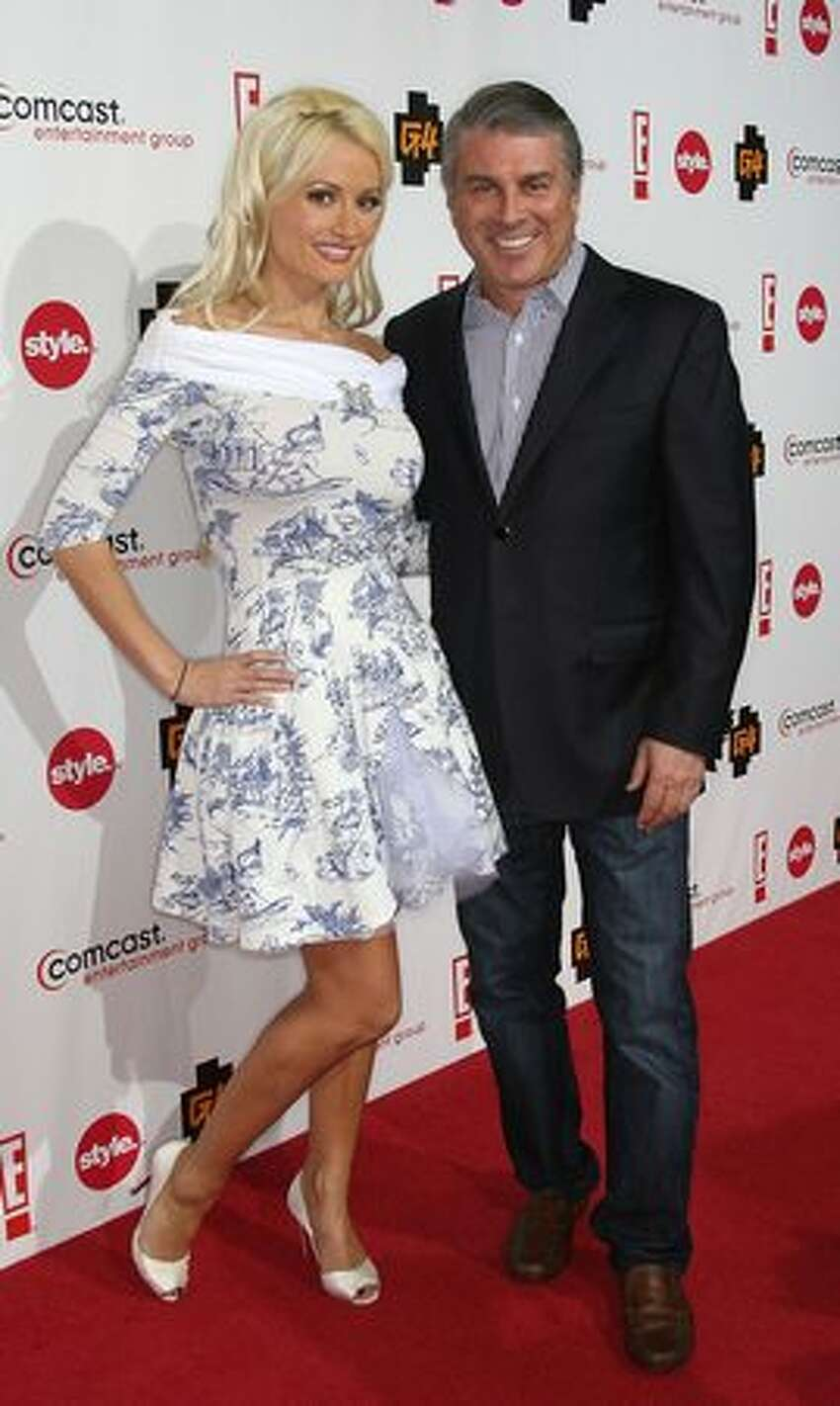 Actress Holly Madison, left, and Ted Harbert, President/CEO, Comcast Entertainment Group arrive.