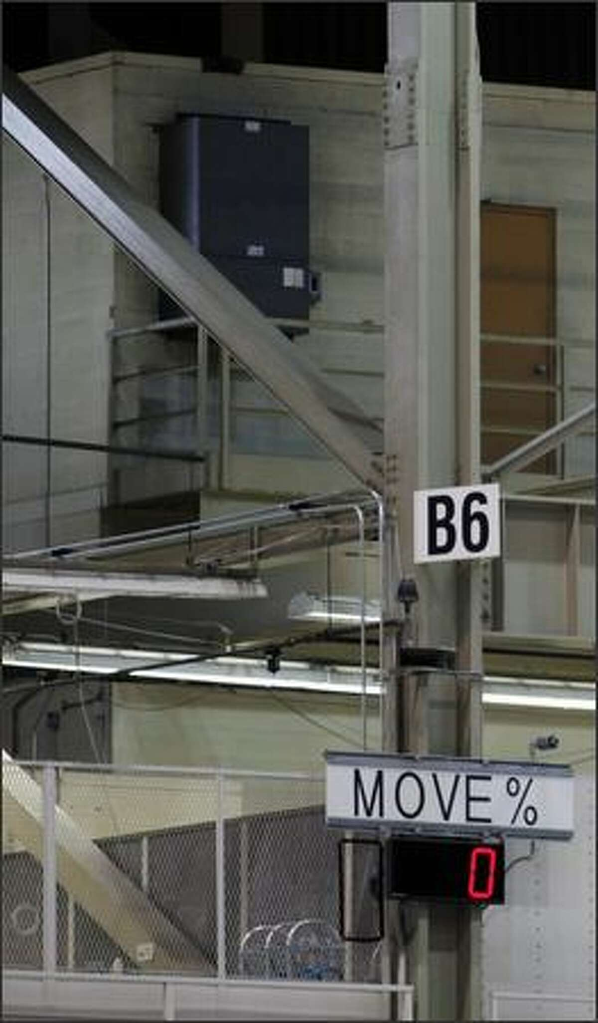 Electronic signs are displayed to help workers and management identify and fix problems along the assembly line. This sign's 0 percent move indicates that no planes have moved forward on the assembly line by that point in the day.