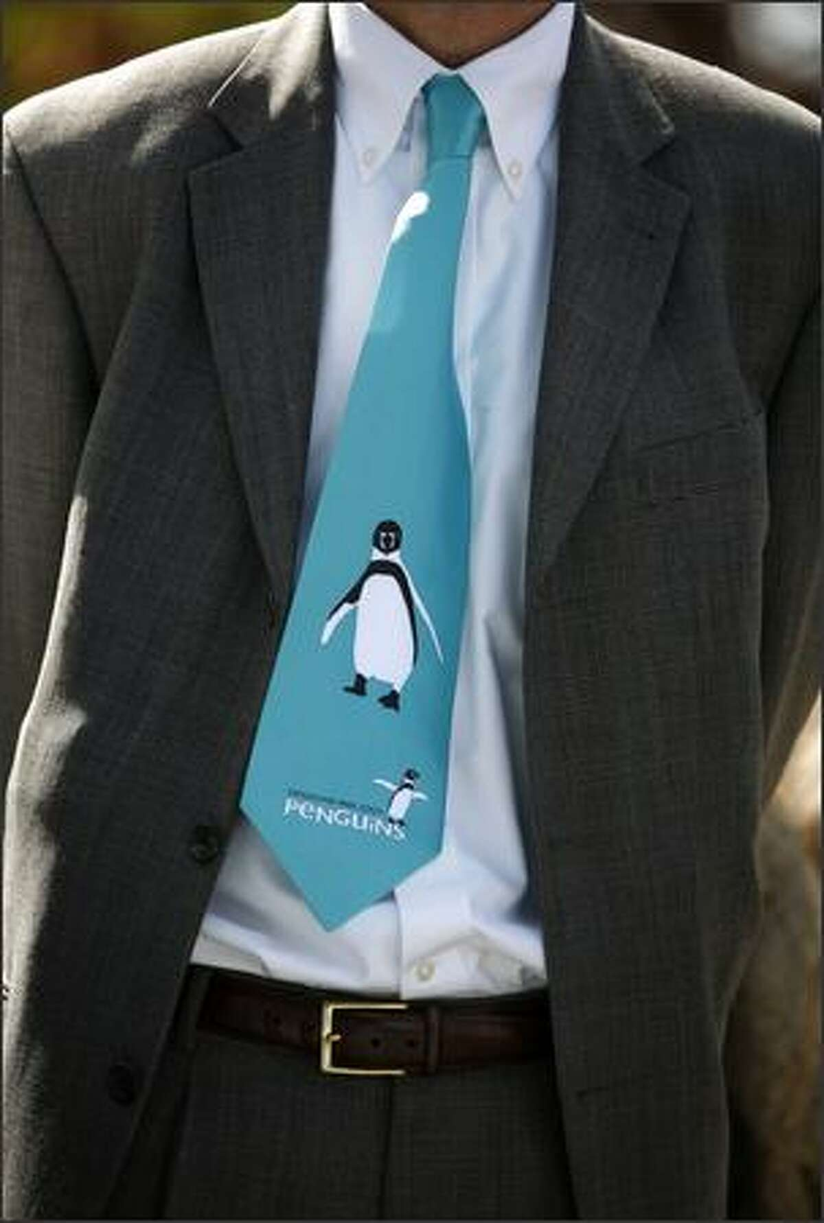 A visitor to the Humboldt penguins exhibit sports an appropriate neck tie on Friday at the Woodland Park Zoo in Seattle.
