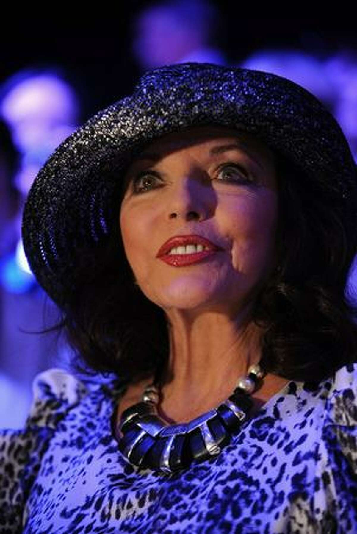 Joan Collins attends the Caroline Charles Fashion Show during London Fashion Week at Somerset House in London, England.
