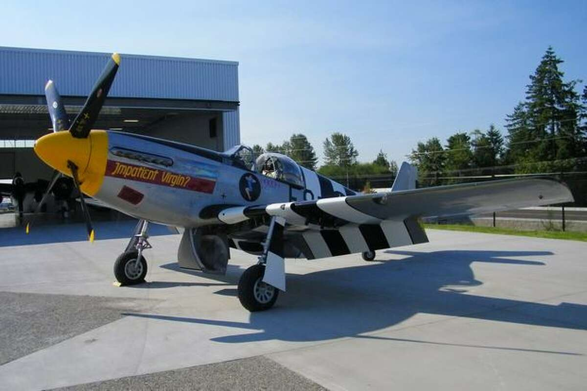 """A North American P-51 Mustang """"Impatient Virgin"""" on display at the Historic Flight Foundation, at Everett's Paine Field."""