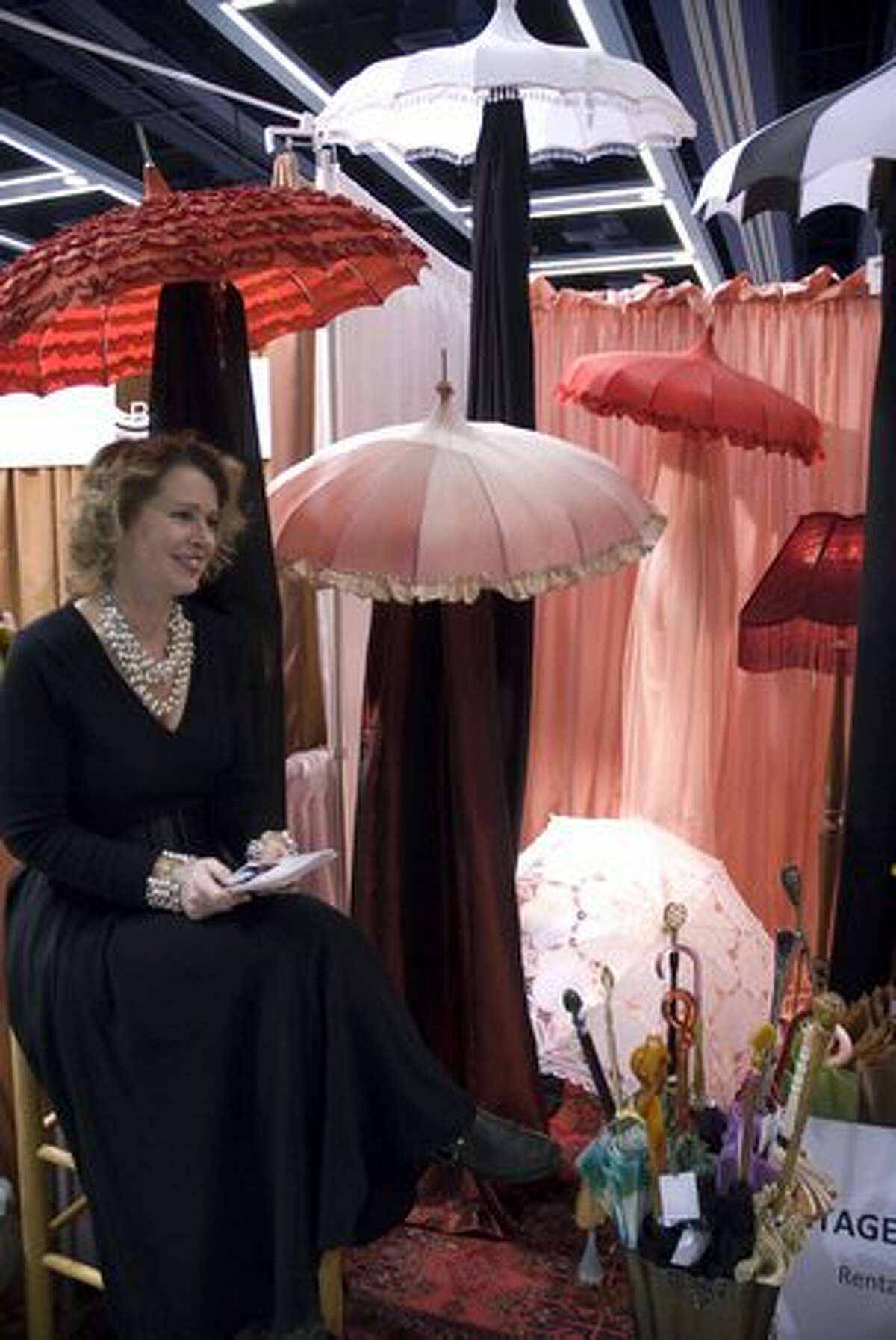 Jodell Egbert sells vintage umbrellas for brides and bridesmaids at Bella Umbrellas. The 20th annual Seattle Wedding Show took place at the Washington State Convention and Trade Center Jan. 16-17. Read about the 5 coolest booths at the show here. (Rebecca Livingston/seattlepi.com)